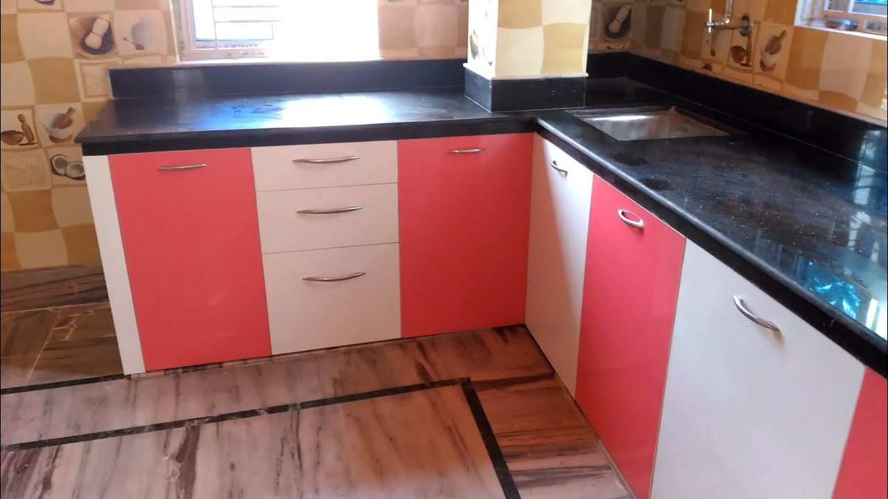 pink and white color modular kitchen